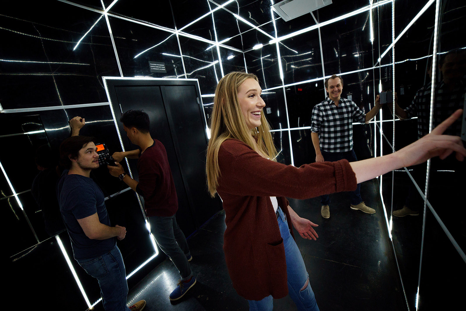 Individuals solving a puzzle in an escape room